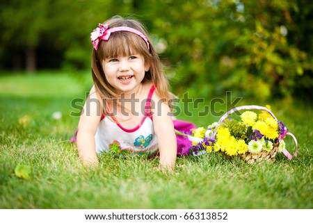 Smiling little girl on the meadow - stock photo