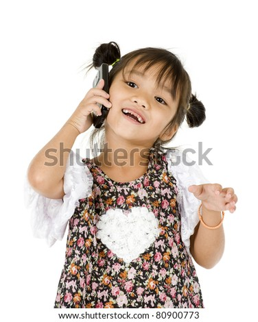 smiling little girl on the phone over white background - stock photo