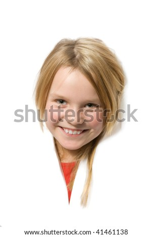 Smiling little girl popping head through white surface - stock photo