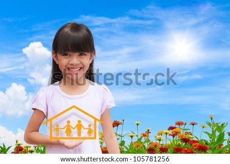 Smiling little girl showing on family symbol with nice sky background - stock photo