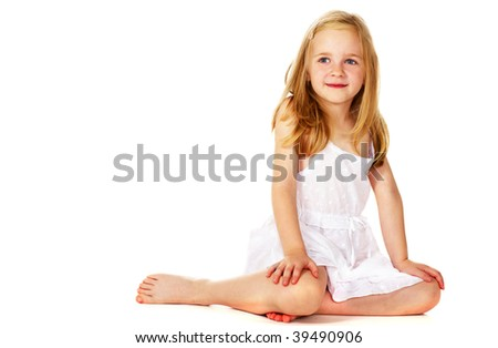 smiling little girl sitting on floor - stock photo