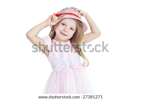 Smiling little girl trying on hat with red band