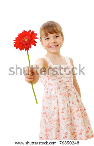 Smiling little girl wearing summer dress standing and holding red flower.