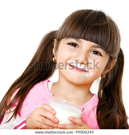 smiling little girl with a glass of milk