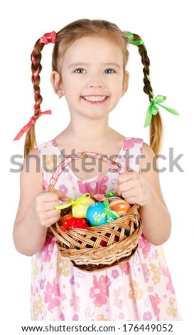 Smiling little girl with basket full of colorful easter eggs isolated on a white - stock photo