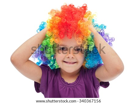 Smiling little girl with clown hair - portrait isolated on white - stock photo