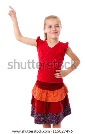 Smiling little girl with empty pointing lifted up hand, looking to camera, isolated on white - stock photo