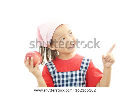 Smiling little girl with fruit - stock photo