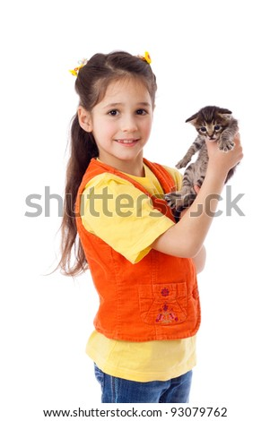 Smiling little girl with scared kitty in hands, isolated on white