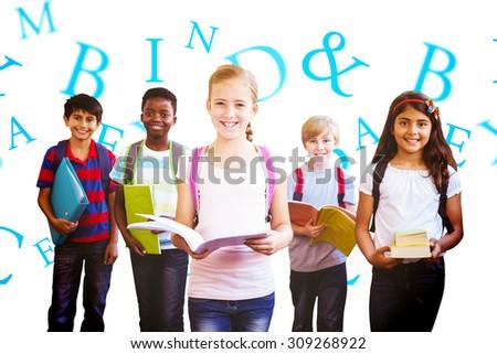 Smiling little school kids in school corridor against letters - stock photo