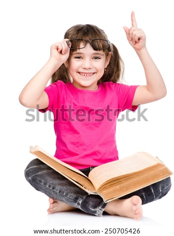 smiling little student girl in eyeglasses with book and finger up. isolated on white background - stock photo