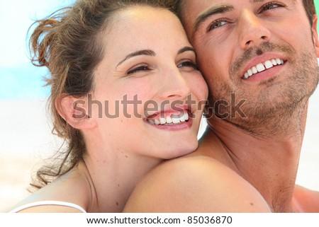 Smiling loving couple - stock photo