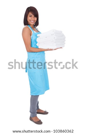 Smiling maid woman with towels. Isolated on white - stock photo