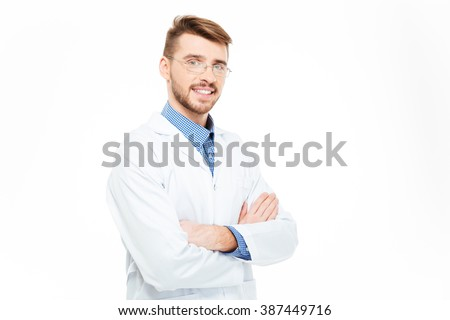 Smiling male doctor in glasses standing with arms folded isolated on a white background - stock photo