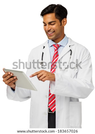 Smiling male doctor using digital tablet isolated over white background. Vertical shot. - stock photo