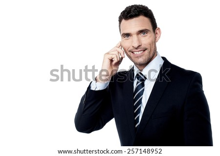 Smiling male entrepreneur using his mobile phone - stock photo