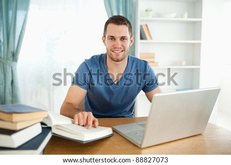 Smiling male student happy about his research results