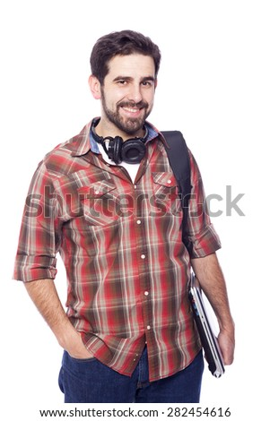 Smiling male student holding a laptop, isolated on white background - stock photo
