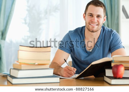 Smiling male student preparing for test