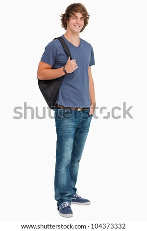 Smiling male student with a backpack against white background - stock photo