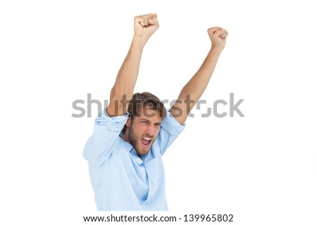 Smiling man celebrating success with arms up on white background