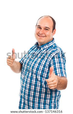 Smiling man gesturing thumbs up, isolated on white background - stock photo