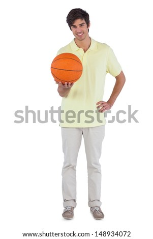 Smiling man holding a basket ball on a white background - stock photo