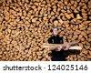 smiling man holding firewood - stock photo