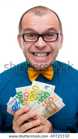 Smiling man holding handful of money isolated on white - stock photo
