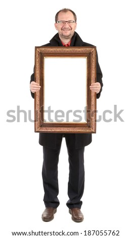 Smiling man holding wooden frame. Isolated on a white background.
