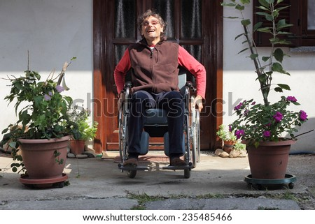 smiling man in a wheelchair - stock photo