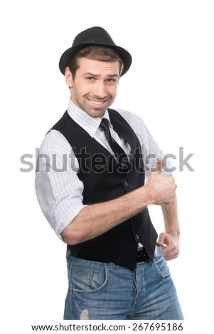 Smiling man in black hat showing something on his hand. Isolated on a white background - stock photo