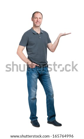 Smiling man in grey t-shirt and jeanse isolated on white background