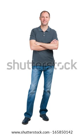Smiling man in grey t-shirt and jeanse isolated on white background - stock photo