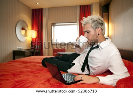 Smiling man in headphones in work place - stock photo