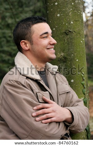Smiling man in Profile, autumnal portrait of a young man. - stock photo