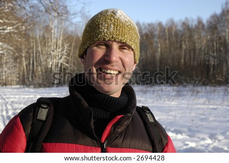 Smiling man in the forest