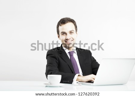 smiling man in the workplace