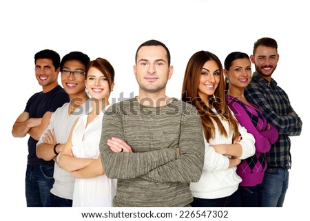 Smiling man leading his happy team over white background