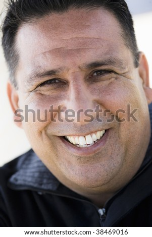 Smiling Man Looking Directly To Camera