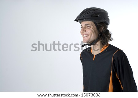 Smiling man wearing a helmet. Horizontally framed photograph - stock photo