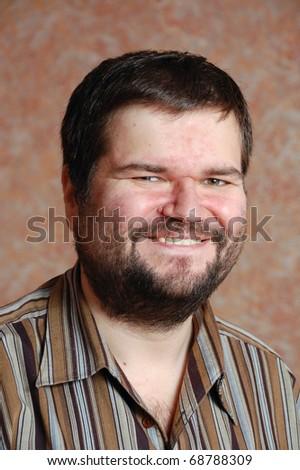 smiling man with beard - stock photo