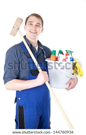 Smiling man with bucket full of cleanser and scrub - stock photo
