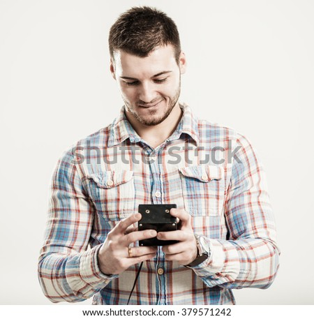 smiling man with device in hands want to push the button