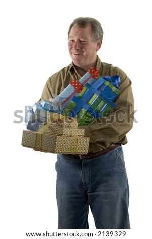 smiling man with gifts wrapped in boxes - stock photo
