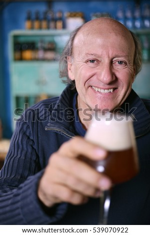 Smiling man with glass of beer