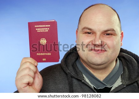 smiling man with passport - stock photo