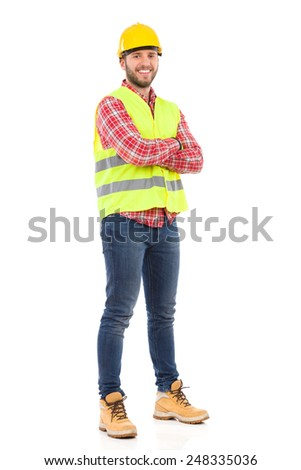 Smiling manual worker. Smiling construction worker in yellow helmet and lime waistcoat. Full length studio shot isolated on white. - stock photo