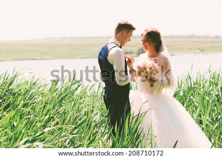 smiling married couple in high grass