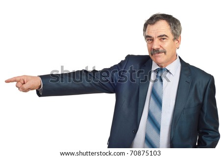 Smiling mature business man pointing in left part of image to copy space isolated on white background - stock photo